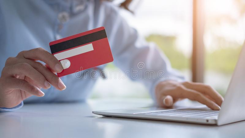 Hands holding credit card and using laptop, Online shopping, making online payment.  stock photo