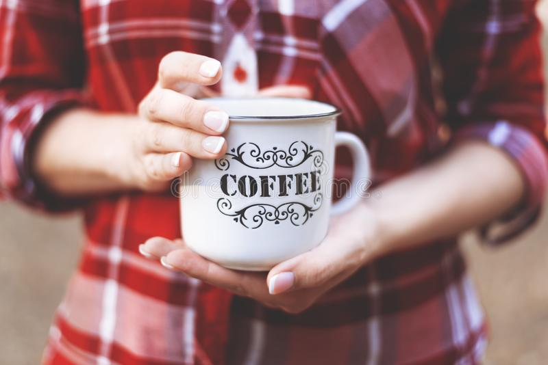 Hands holding a Cup with the inscription coffee stock image