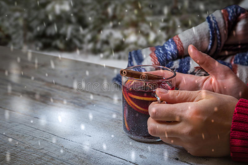 Hands holding cup of mulled wine royalty free stock images