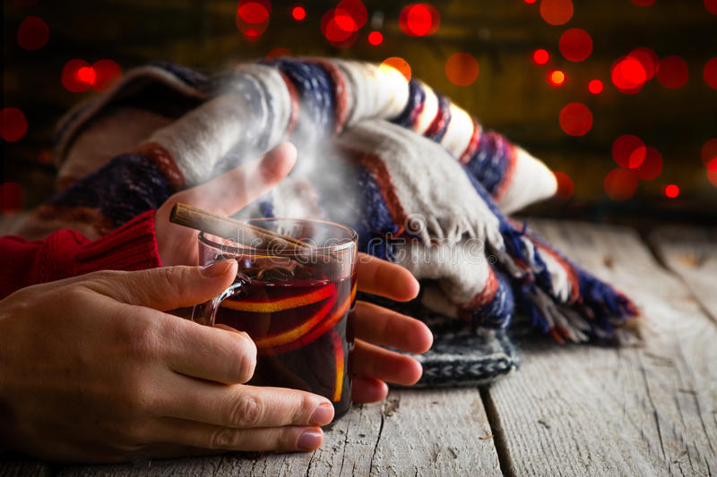 Hands holding cup of mulled wine royalty free stock photography