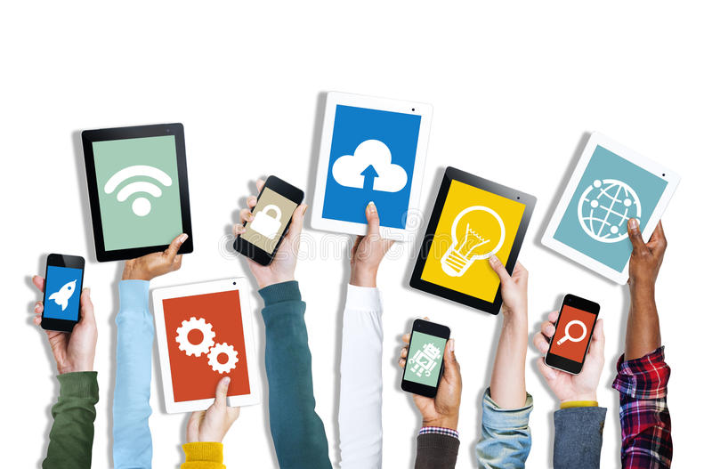 Hands Holding Digital Devices with Various Symbols stock photo