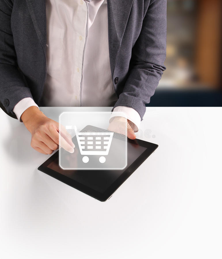 Hands holding digital tablet. Hands holding and pointing on contemporary digital tablet royalty free stock image