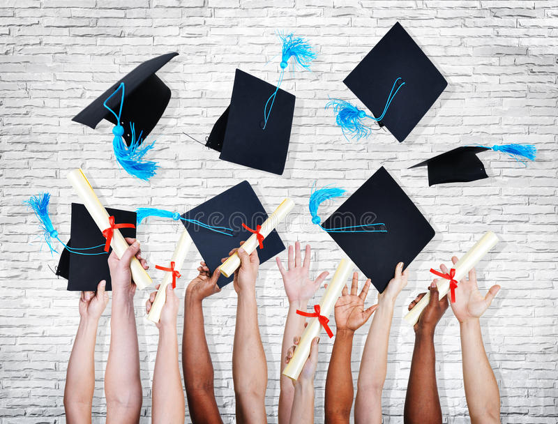 Hands Holding Diplomas And Throwing Hats royalty free stock image