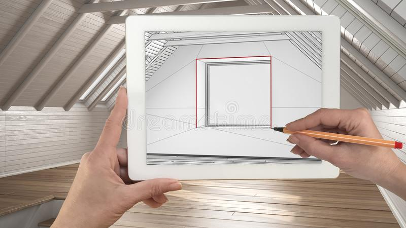 Hands holding and drawing on tablet showing modern empty interior sketch. Real finished interior with no people and furniture in royalty free stock photography