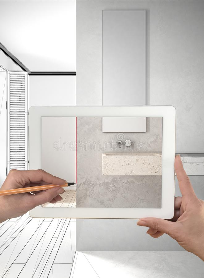 Hands holding and drawing on tablet showing real finished minima stock photo