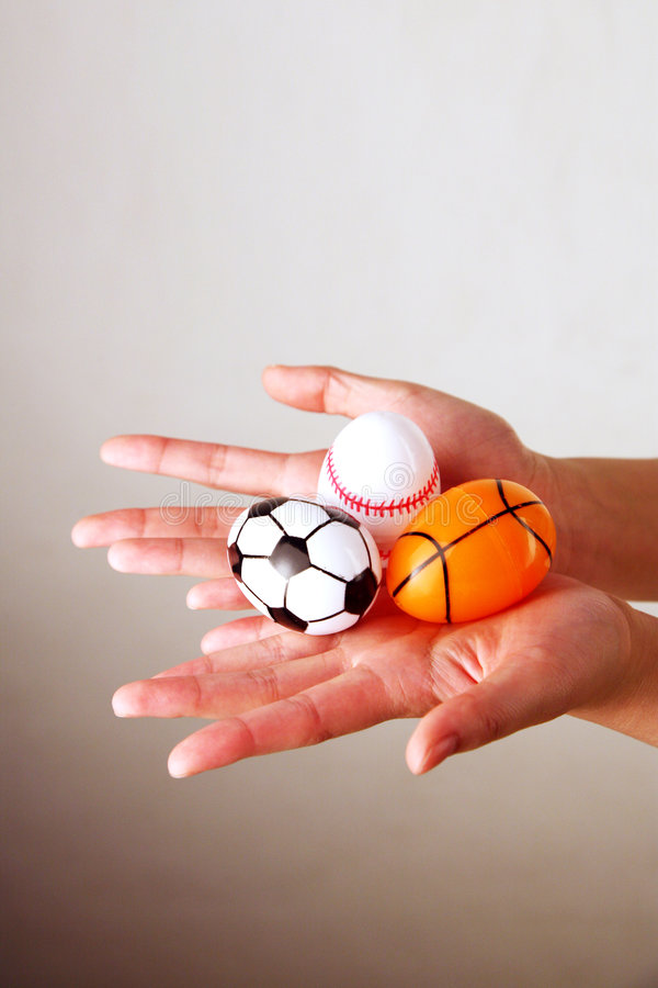 Hands holding Easter eggs stock image