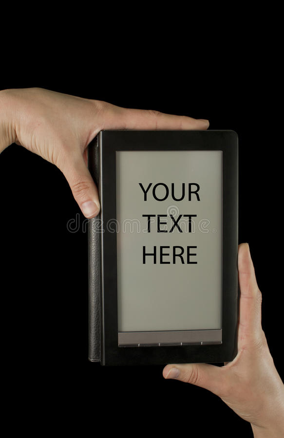 Hands holding an electronic book reader. On the black background royalty free stock photos