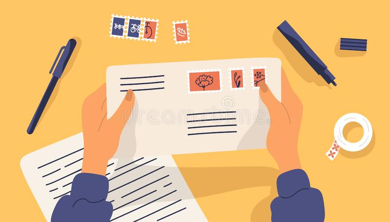 Hands holding envelope with stamps surrounded by stationery. Top view on table surface. Sending written letter or. Correspondence through postal service. Flat vector illustration