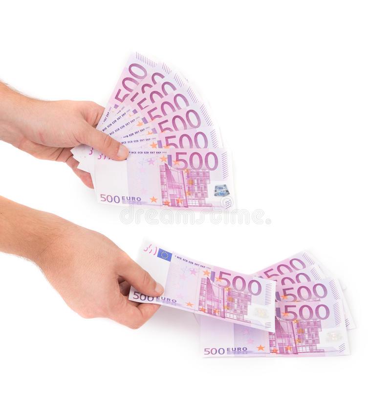 Hands holding euros banknotes. Hands holding 500 euros banknotes on the white royalty free stock photo