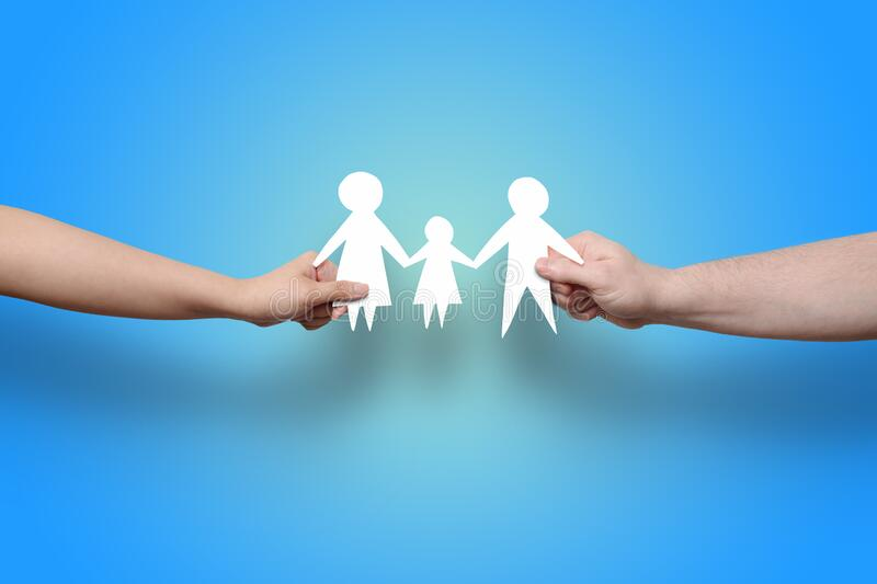 Hands holding family paper cut out royalty free stock image