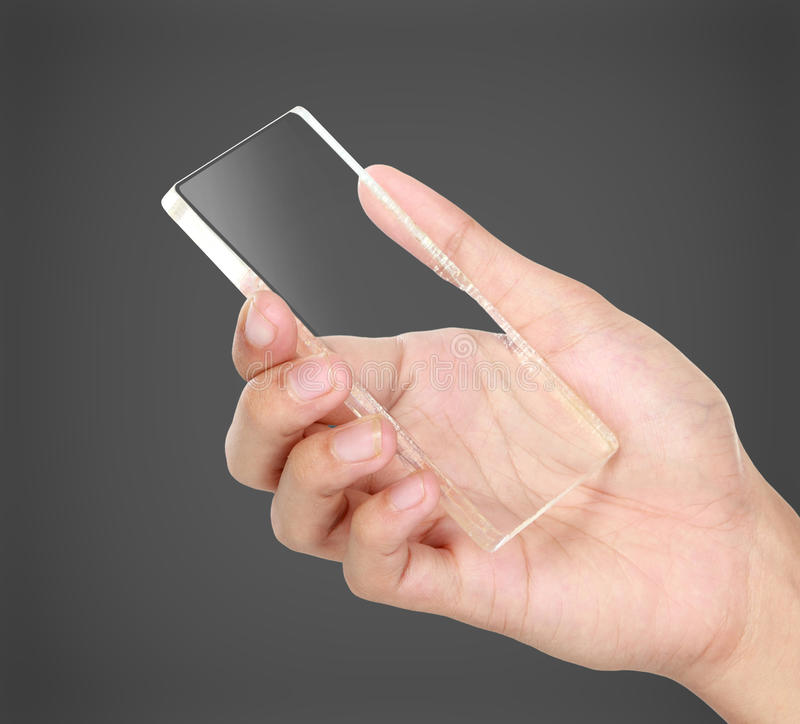 Hands holding futuristic transparent mobile phone royalty free stock photos