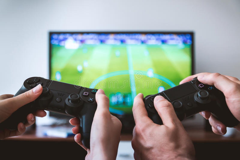Hands holding gamepads stock photo