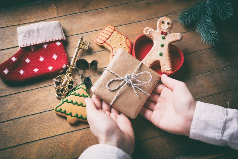 Hands holding gift box and sock royalty free stock photography