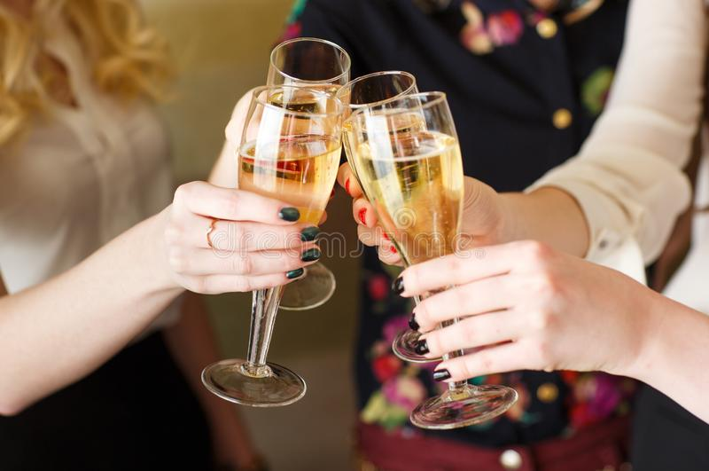 Hands holding the glasses of champagne making a toast. Hands holding the glasses of champagne making a toast stock photo