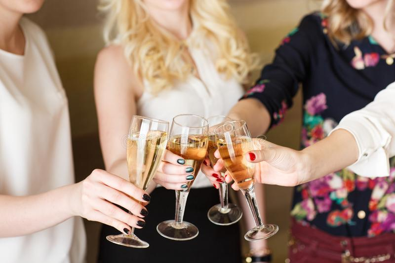 Hands holding the glasses of champagne making a toast. Hands holding the glasses of champagne making a toast stock photography