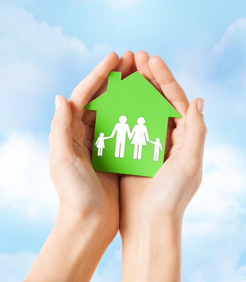 Hands holding green house with family royalty free stock photos