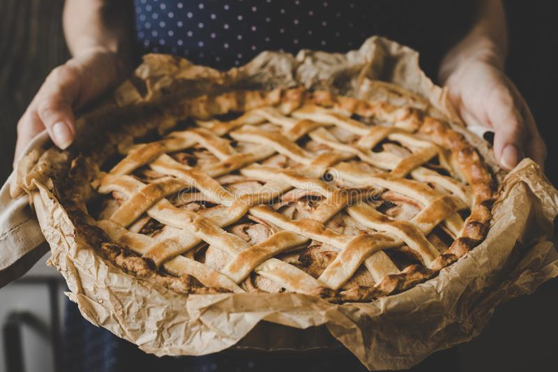 Hands holding homemade delicious apple pie. Close up stock images