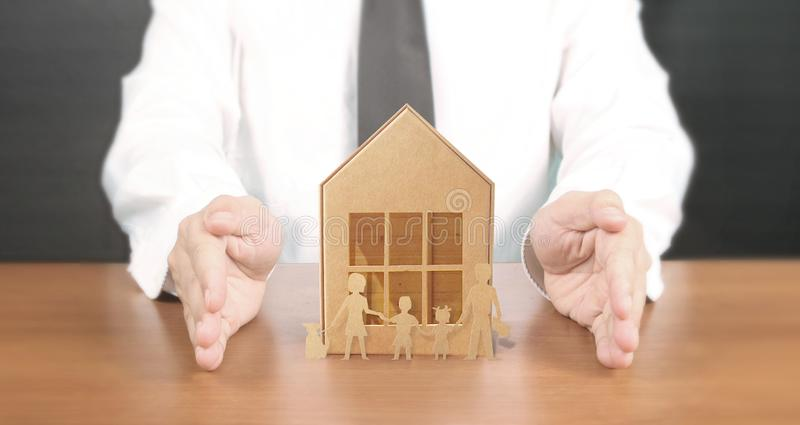 Hands holding  house homeless housing shelter real estate , family house insurance concept royalty free stock images