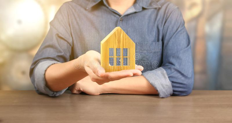 Hands holding  house homeless housing shelter real estate , family house insurance concept royalty free stock photos