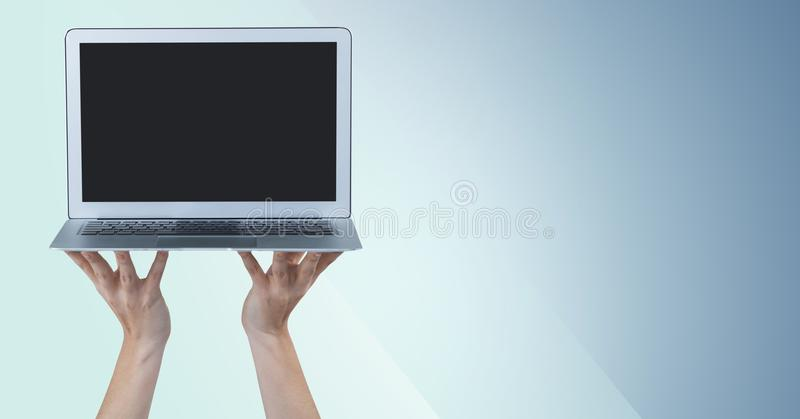 Hands holding laptop against blue background. Digital composite of Hands holding laptop against blue background stock photo