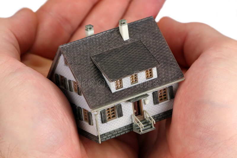 Hands Holding A Miniature Home Stock Image