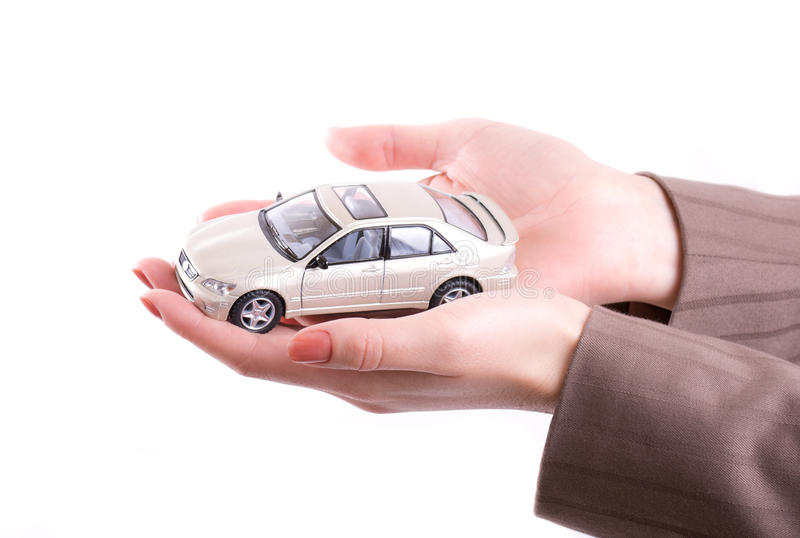 Hands holding the model of car. Woman's hands holding the model of car royalty free stock photos