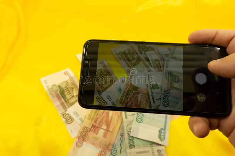 Hands holding modern mobile telephone dollar and euro symbols flaying away E-business concept royalty free stock image
