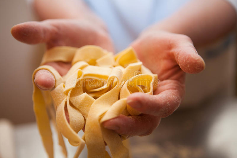 Hands holding noodles stock photography