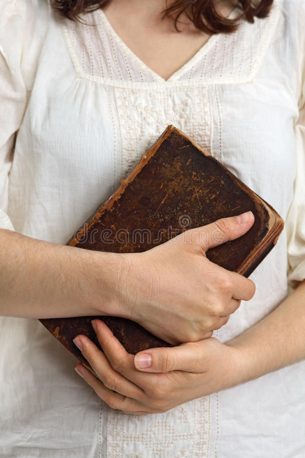 Hands holding old bible royalty free stock images