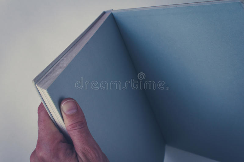 Hands holding open book with blank pages royalty free stock photography