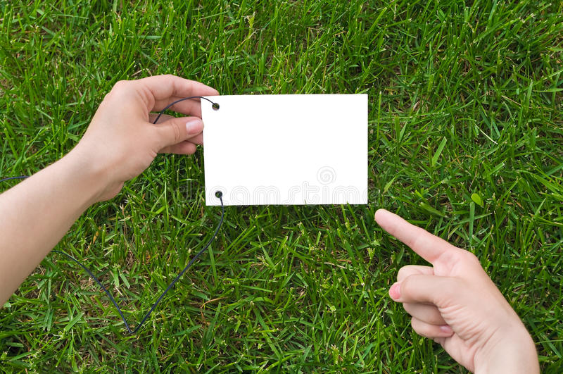 Hands holding a paper note stock images