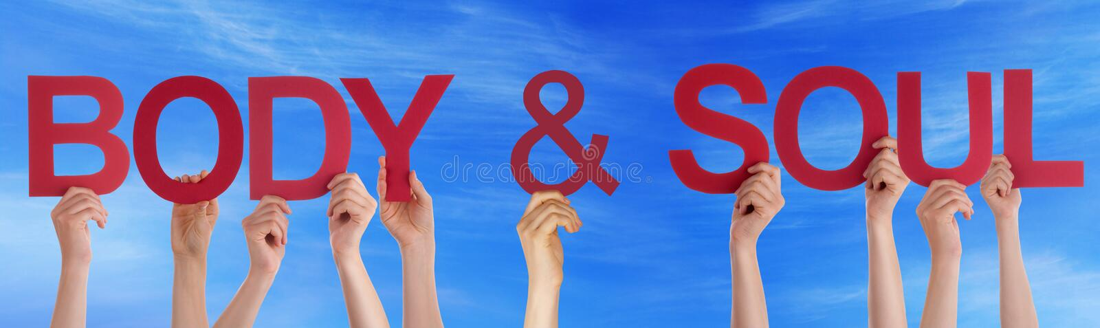 Hands Holding Red Straight Word Body Soul Blue Sky. Many Caucasian People And Hands Holding Red Straight Letters Or Characters Building The English Word Body And royalty free stock photography