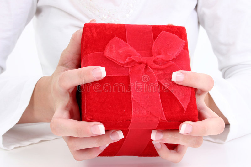 Hands Holding Red Velvet Gift Box stock photo