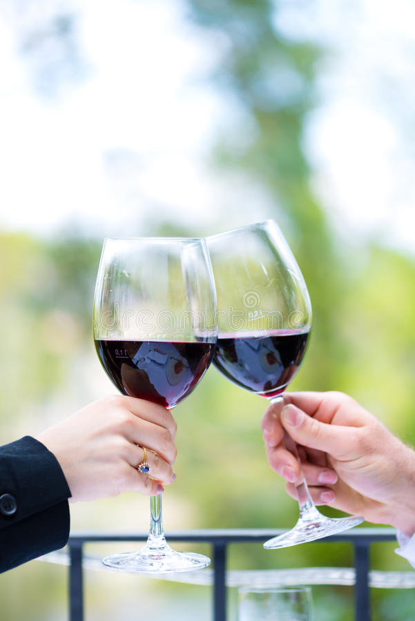 Download Hands Holding Red Wine Glasses To Clink Stock Image - Image: 32187989