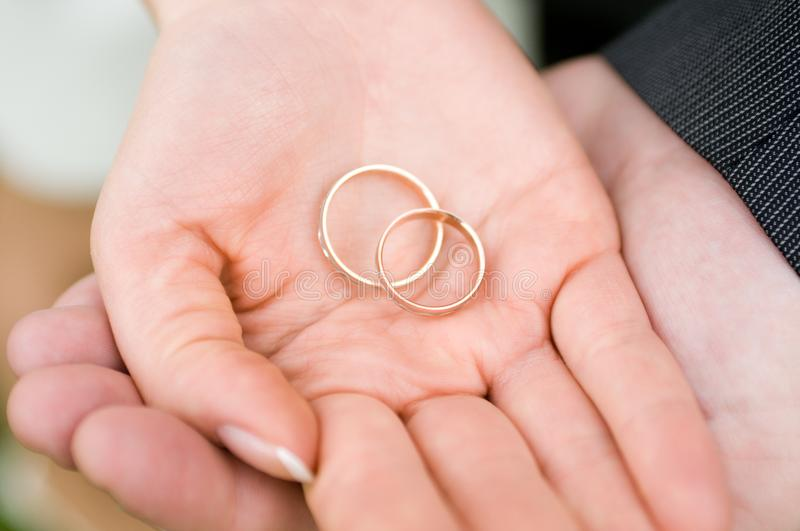Hands holding rings stock photography