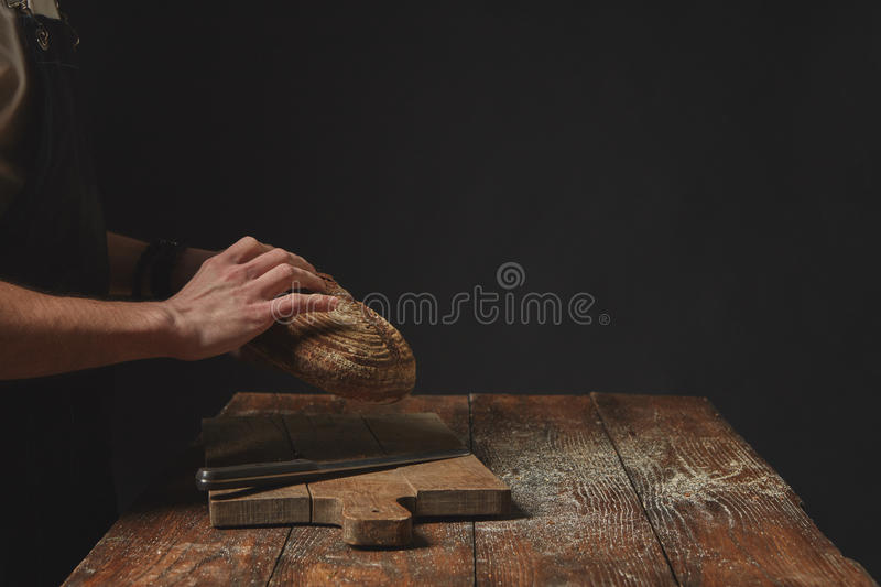 Hands holding round bread stock photos