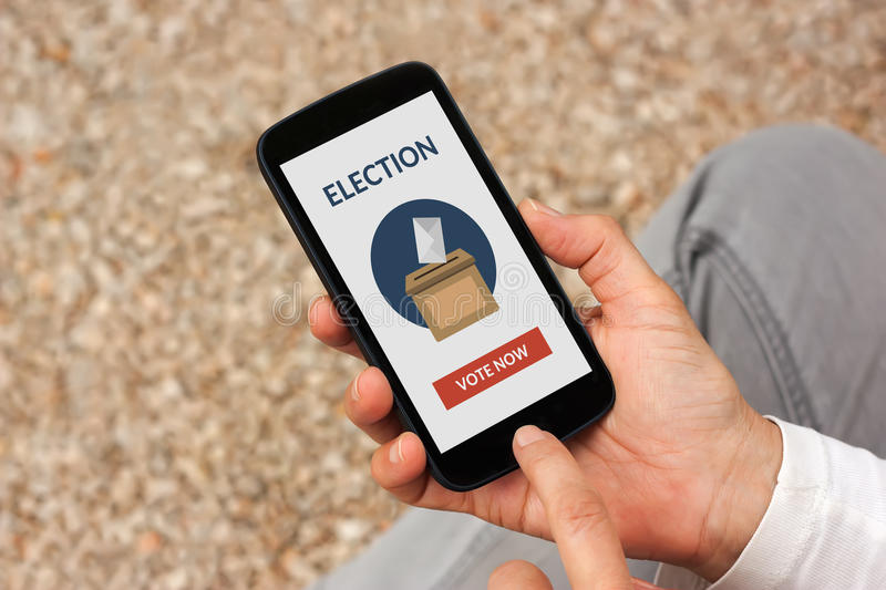 Hands holding smart phone with online voting concept on screen. All screen content is designed by me stock image
