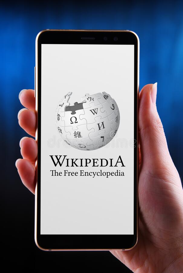 Free Hands Holding Smartphone Displaying Logo Of Wikipedia Stock Images - 186520904