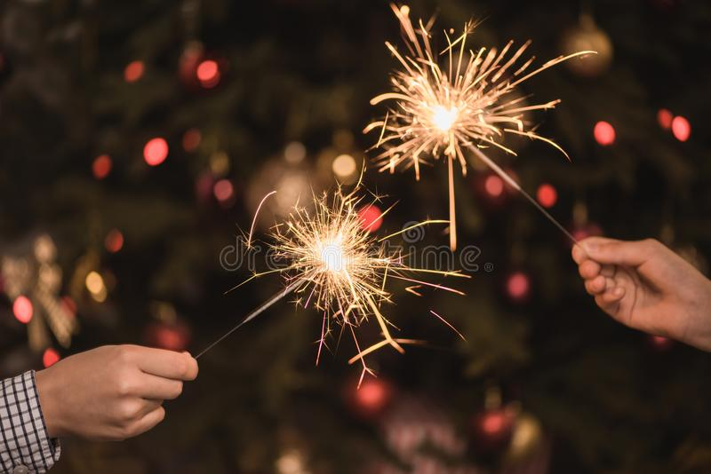 Hands holding sparklers royalty free stock image
