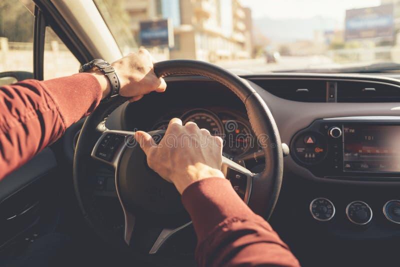 Hands holding steering wheel stock photos