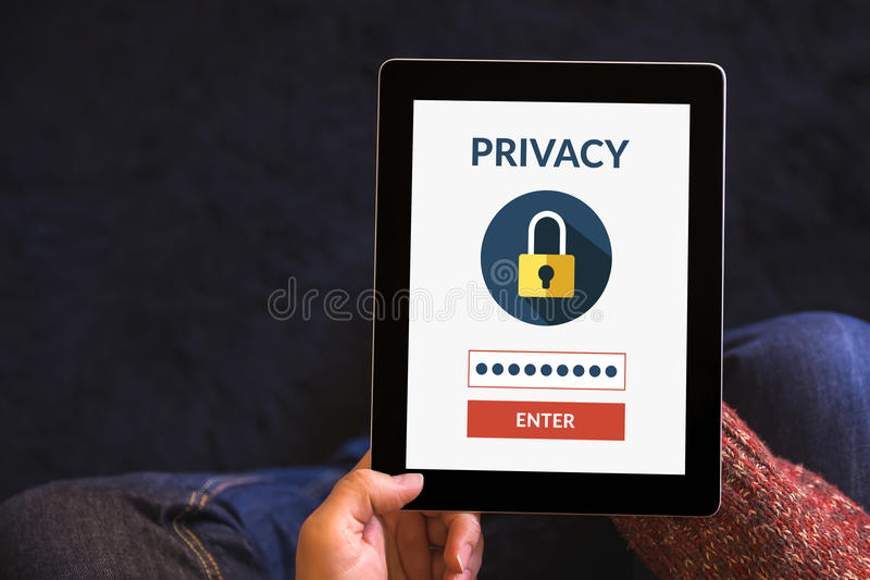 Hands holding tablet computer with online privacy concept on screen. Hands holding digital tablet computer with online privacy concept on screen. All screen stock photography