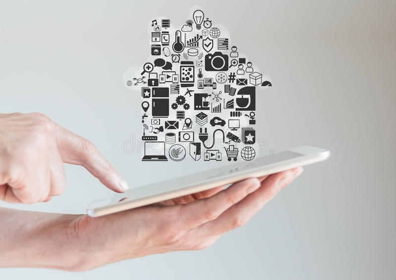 Hands holding tablet with smart home automation and mobility concept royalty free stock photos