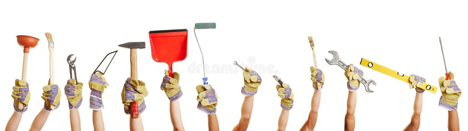 Hands holding tools for working. Many hands holding different tools for working and fixing things stock photography