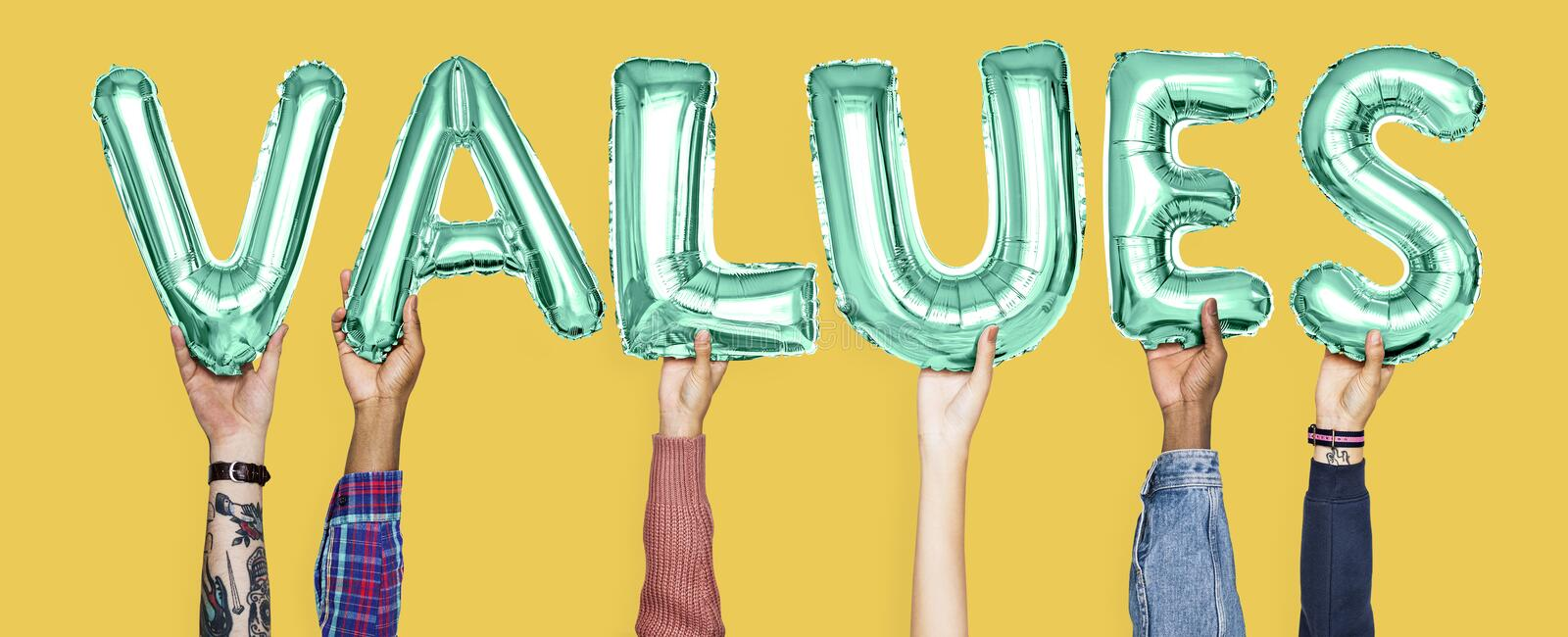Hands holding values word in balloon letters royalty free stock photography