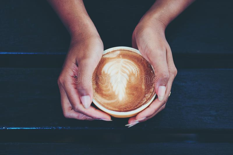 Hands and hot coffee to drink coffee every morning of coffee lovers. Morning coffee is served. Food and Drink Concepts stock photos
