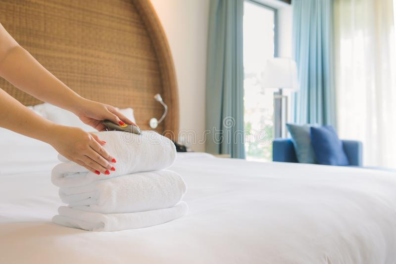 Hands of hotel maid bringing fresh towels to the room.  stock photos