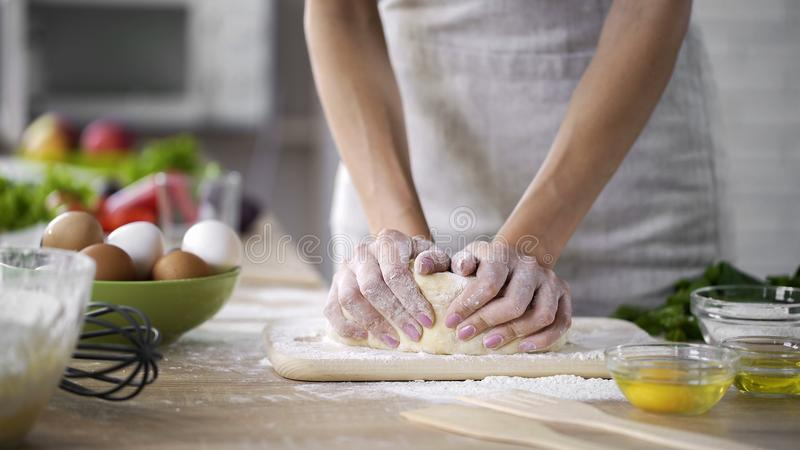 Hands of housewife kneading the dough at home, method of preparing biscuits royalty free stock photo