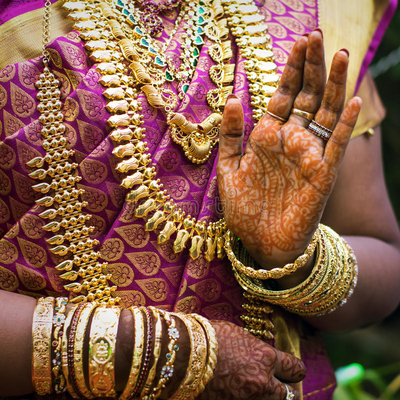 Hands of an Indian bride adorned with jewelery stock image
