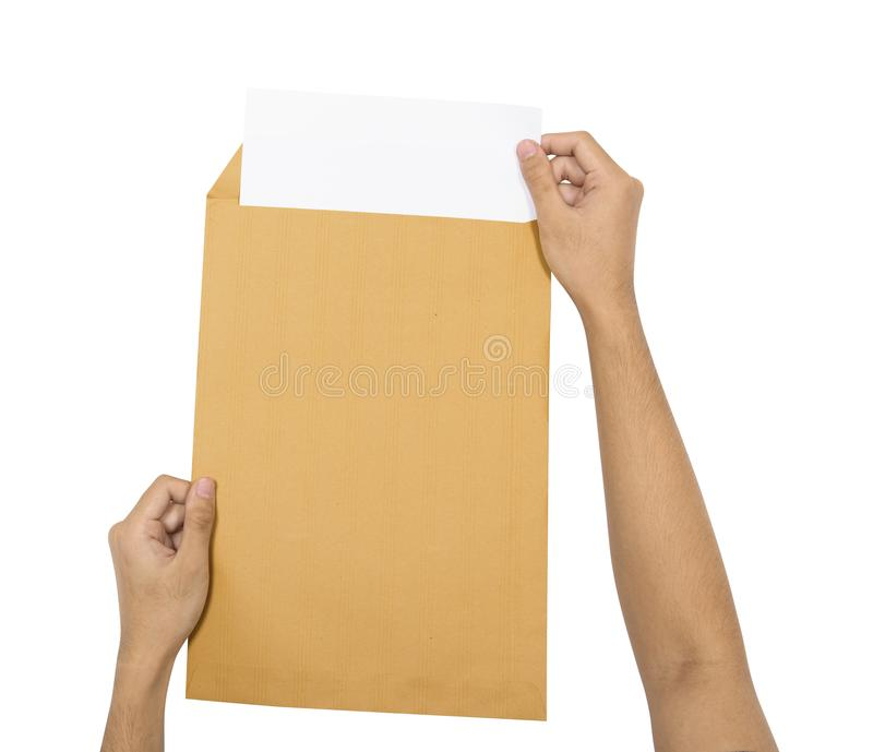 Hands insert the paper into brown envelope stock photo