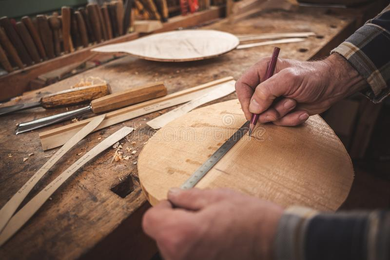 Instrument maker working with his hands royalty free stock images
